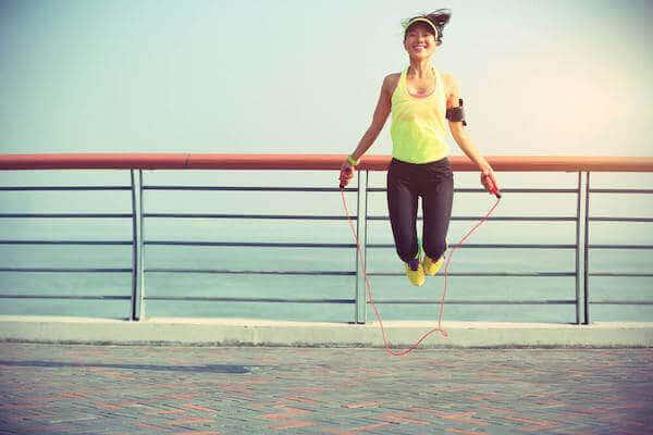 healthy woman jump roping