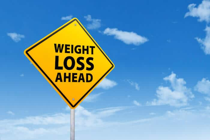 weight loss hacks yellow road sign