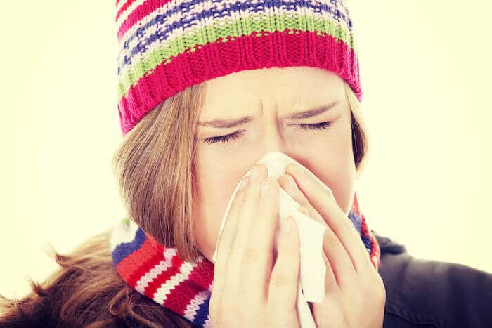 support immune system woman blowing nose