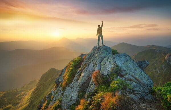 victory man on mountain top