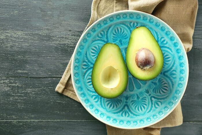 avocado superfood on teal plate