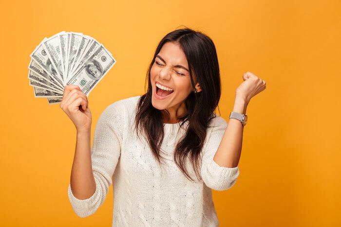 woman celebrating prosperity